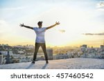 man with open arms facing a... | Shutterstock . vector #457460542