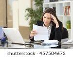worried businesswoman reading a ... | Shutterstock . vector #457504672