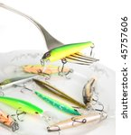 Fork with artificial fishing bait, similar lures lie on porcelain plate - stock photo