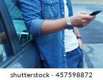young man leaning on his car ... | Shutterstock . vector #457598872