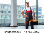 young carpenter working at... | Shutterstock . vector #457612852