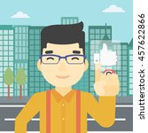 an asian young man pressing...   Shutterstock .eps vector #457622866
