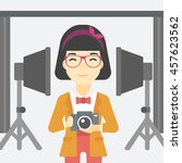 an asian young photographer... | Shutterstock .eps vector #457623562