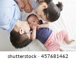 asian baby with parents  lying... | Shutterstock . vector #457681462