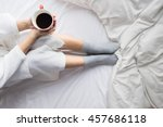 young woman drinking her coffee ... | Shutterstock . vector #457686118