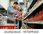 Couple Shopping At Supermarket...
