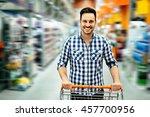 handsome man in rush shopping... | Shutterstock . vector #457700956
