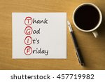 Small photo of TGIF - Thank God It's Friday - handwriting on notebook with cup of coffee and pen, acronym business concept