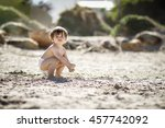 A Photograph Of A Toddler On...