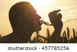 young man drinking water from a ... | Shutterstock . vector #457785256