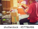 man using tablet pc in warehouse | Shutterstock . vector #457786486