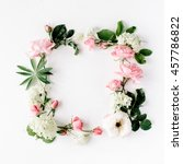 Stock photo flat lay frame with pink and white roses branches leaves and petals isolated on white background 457786822
