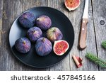 Figs On Black Plate On Wooden...