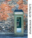 Small photo of Old vintage Irish telephone box and brick wall texture in rural Ireland