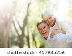 senior couple standing outdoors  | Shutterstock . vector #457935256