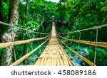 Stock photo bamboo pedestrian hanging bridge over river in tropical forest bohol philippines southeast asia 458089186
