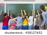 young teacher teaches children... | Shutterstock . vector #458127652