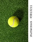 Tennis Ball Against Grass...