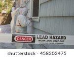 two house painters in hazmat... | Shutterstock . vector #458202475
