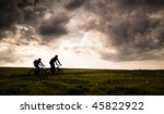 two cyclist biking at sunset | Shutterstock . vector #45822922