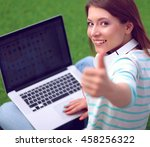 young woman with laptop sitting ... | Shutterstock . vector #458256322