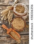 wheat in a bag  bowl and wooden ... | Shutterstock . vector #458336356