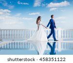 happy wedding couple walking... | Shutterstock . vector #458351122