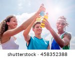 Stock photo athletes taking a break after training drinking colorful energy drink or sports drink concept of 458352388