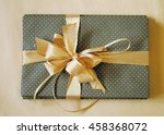 green gift box with gold ribbon | Shutterstock . vector #458368072