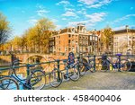 bicycles parked on a bridge in... | Shutterstock . vector #458400406