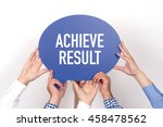 Small photo of Group of people holding the ACHIEVE RESULT written speech bubble