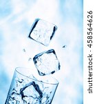 ice cubes falling into a glass... | Shutterstock . vector #458564626