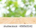 wood table top on shiny bokeh... | Shutterstock . vector #458565142