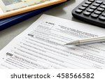 tax form with pen and... | Shutterstock . vector #458566582