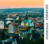Small photo of Evening View Of Cityscape Of Prague, Czech Republic. In The Right Part Of Photo We Can See The Blue Dome Of The Straka Academy. The Straka Academy Is The Seat Of The Government Of The Czech Republic