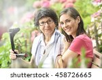 senior woman with home carer... | Shutterstock . vector #458726665