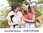 senior disabled woman and carer ... | Shutterstock . vector #458729008