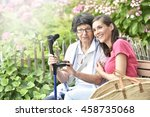 senior woman with home carer... | Shutterstock . vector #458735068