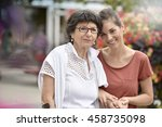 home carer helping disabled... | Shutterstock . vector #458735098