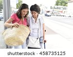 senior woman with home carer... | Shutterstock . vector #458735125