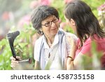 senior woman with home carer... | Shutterstock . vector #458735158