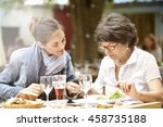 senior woman with home carer... | Shutterstock . vector #458735188