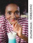 portrait of woman drinking... | Shutterstock . vector #458823442