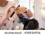 hair stylist is cutting hair of ... | Shutterstock . vector #458936956