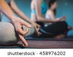 young women meditating indoor... | Shutterstock . vector #458976202