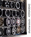 Small photo of variety of up to dated size, brands, colours, and designed alloy rims and wheels on display shelf for sale in a garage wheel shop in KHONKAEN province THAILAND picture taken on 12 July 2016