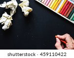 hand hold orange crayon color ... | Shutterstock . vector #459110422