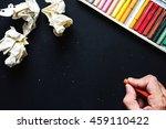 hand hold orange crayon color ...   Shutterstock . vector #459110422