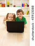 kids with laptop laying on the... | Shutterstock . vector #45915088
