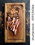 juicy grilled steaks on a... | Shutterstock . vector #459154366